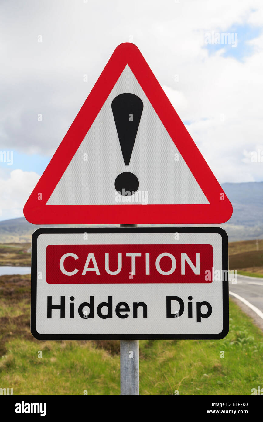 Triangular road sign warning Caution Hidden Dip with exclamation mark in red triangle. Outer Hebrides, Western Isles, Scotland, UK, Britain - Stock Image