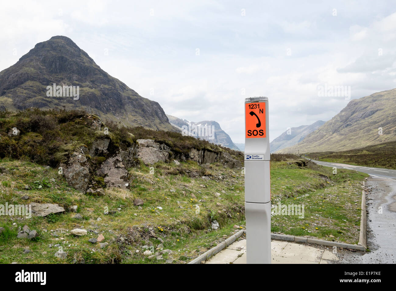 Roadside emergency SOS telephone beside a remote upland country road in mountains. Glen Coe Pass Highland Scotland UK Britain - Stock Image