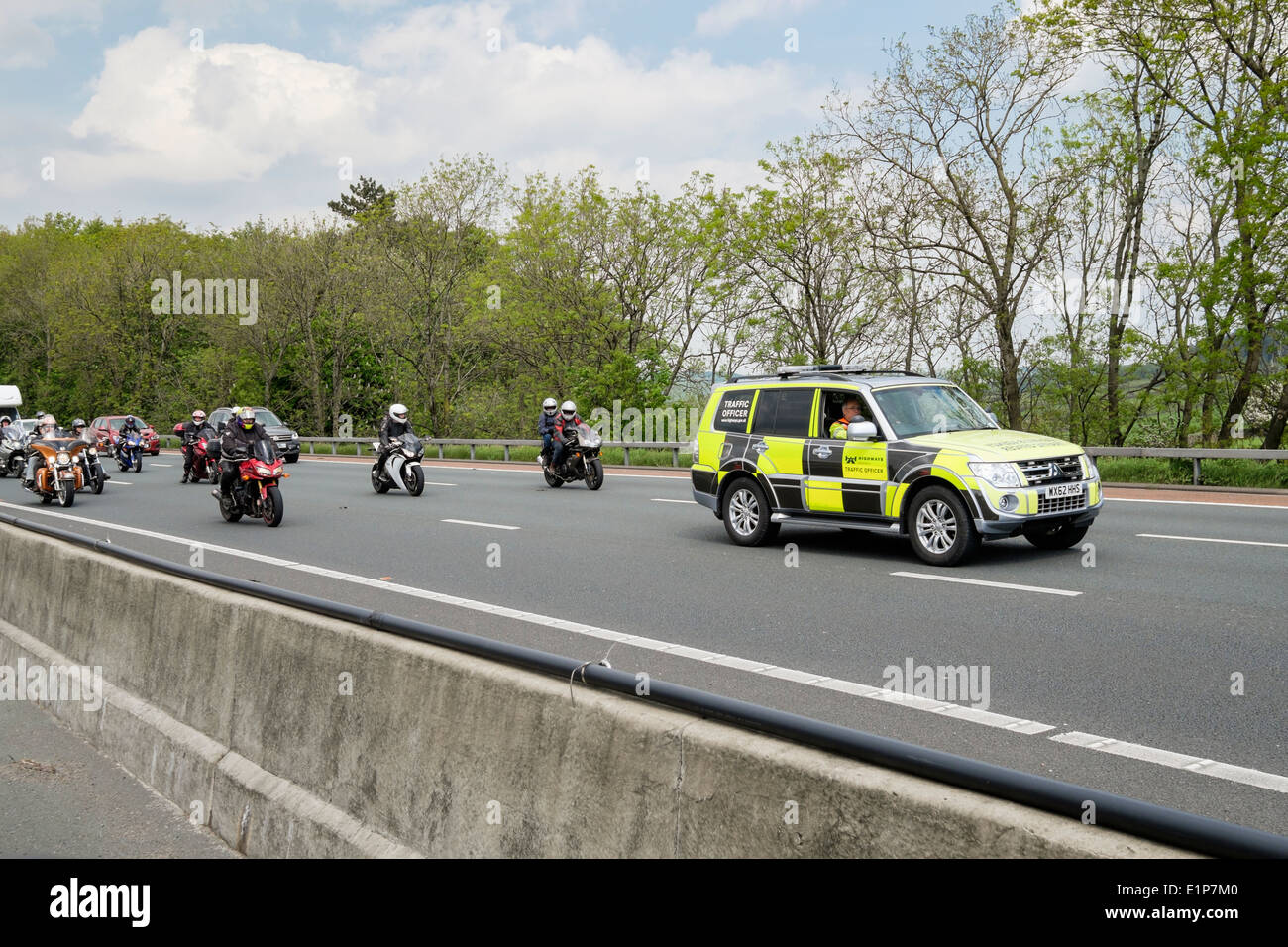 Rolling road block with a Highways Agency vehicle leading motorcycles on M6 motorway following closure. Lancashire, England, UK, Britain - Stock Image