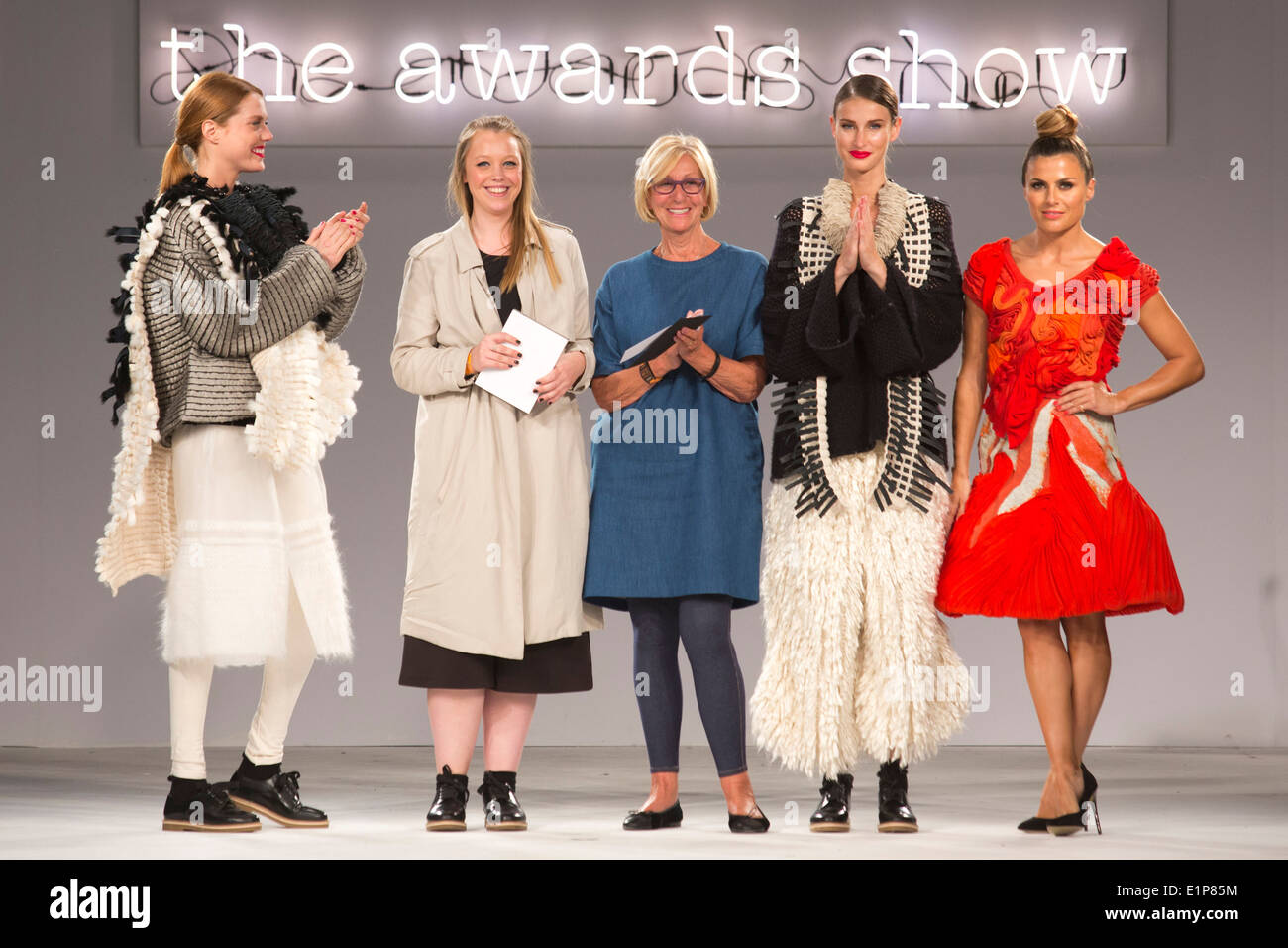Rebecca Swann receives the Stuart Peters Knitwear Award from Erica Peters, Graduate Fashion Week 2014 Awards Show - Stock Image