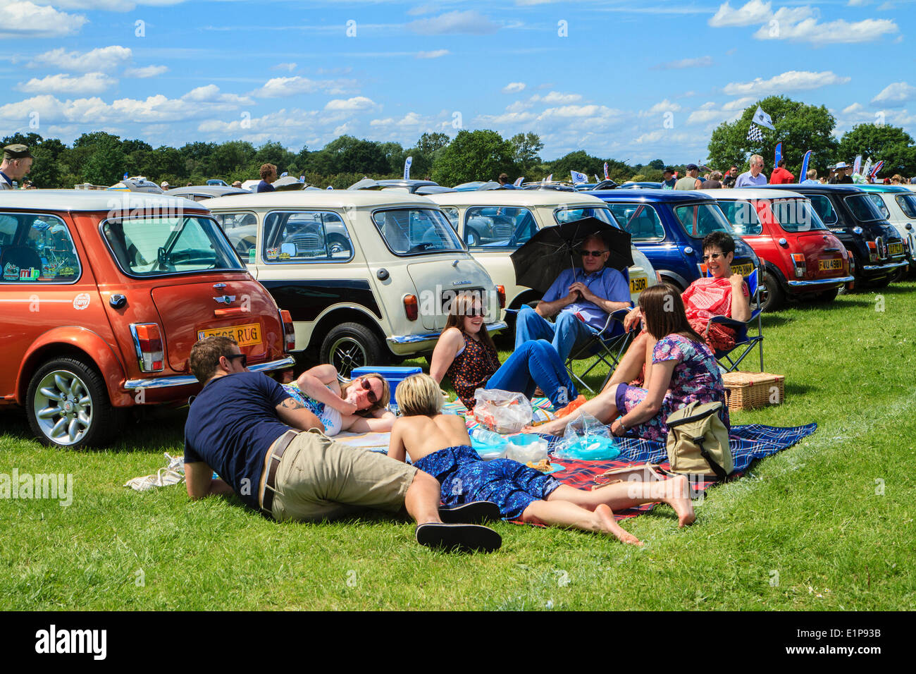 Bromley Pageant of Motoring annual classic car show. Visitors in the Austin Mini area. - Stock Image