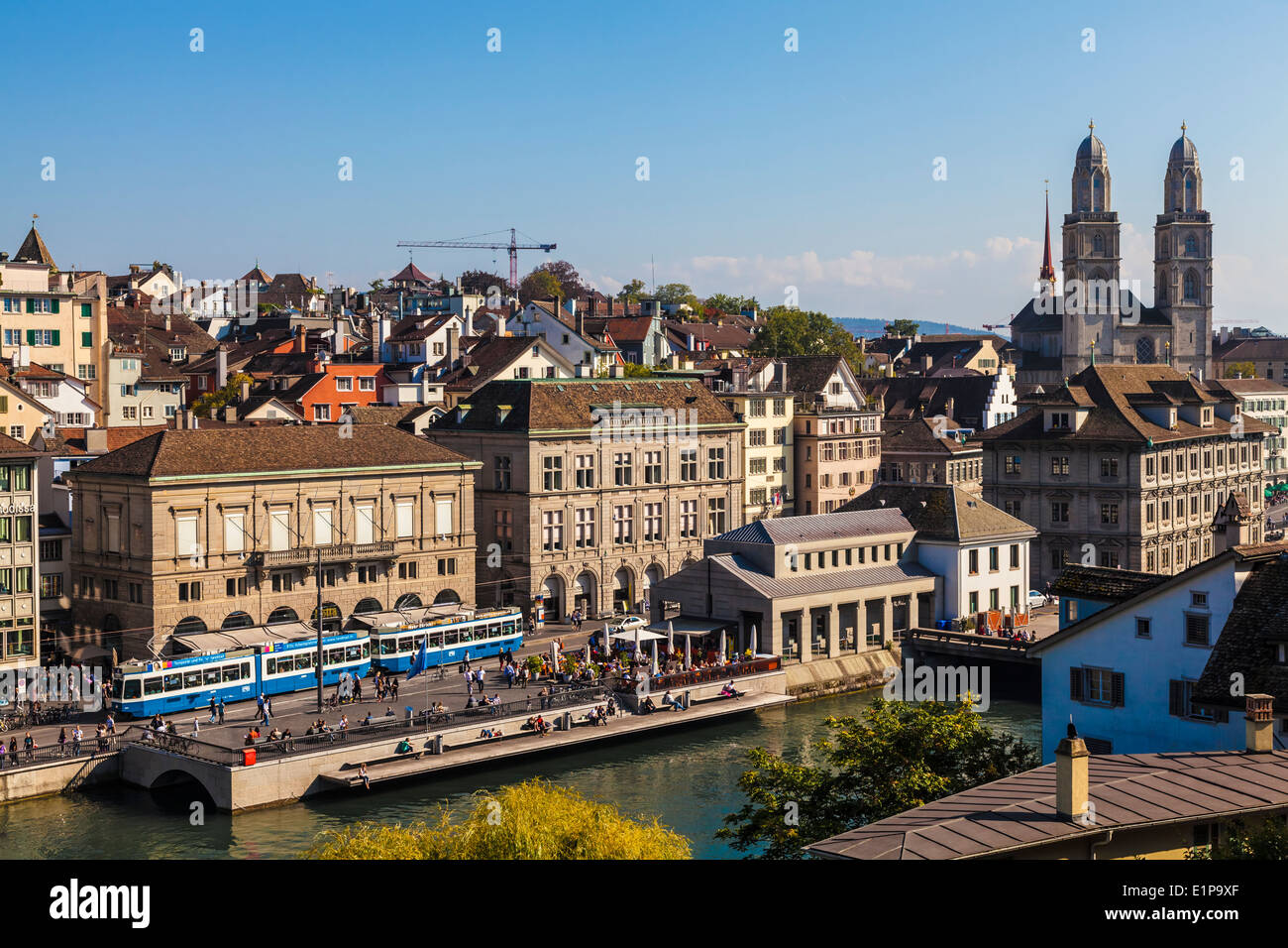 Panorama of Zurich with the Limmat River and Grossmunster Church, Switzerland. Taken on a beautiful sunny day. - Stock Image