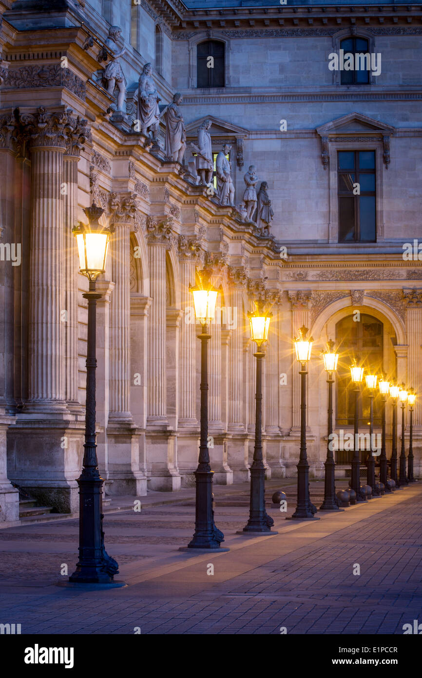 Row of lamps in the courtyard of Musee du Louvre, Paris France - Stock Image
