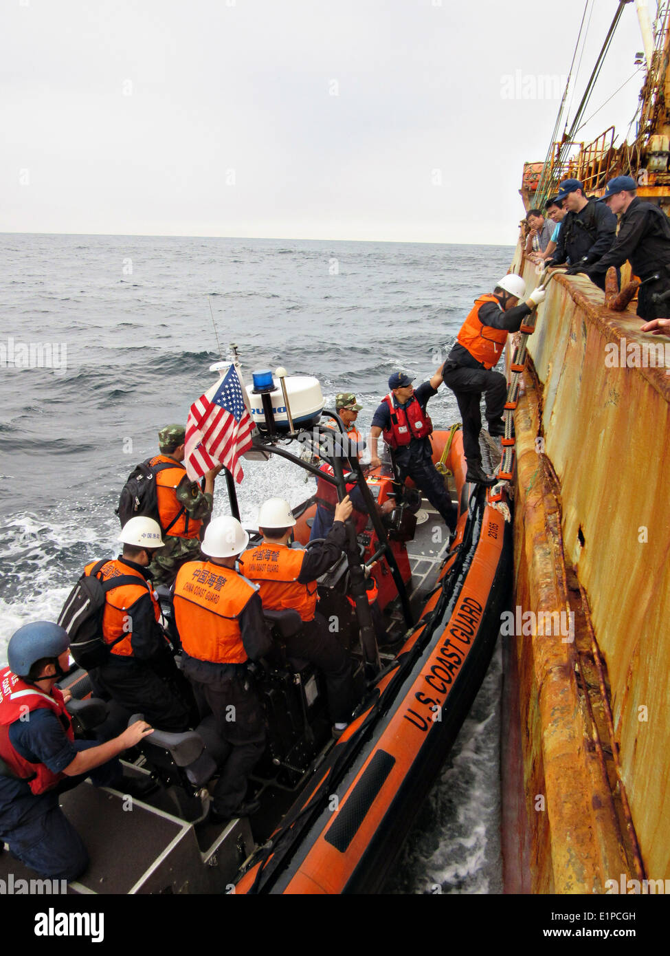 US Coast Guard Cutter Morgenthau crew and members of the China Fisheries Law Enforcement Command board the fishing Stock Photo