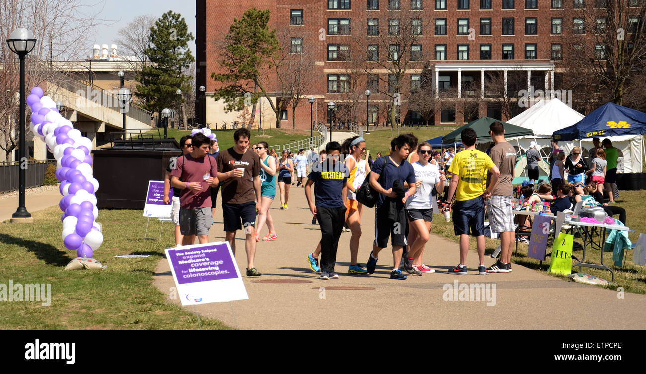 Walkers participate in the University of Michigan's Relay for Life event on April 12, 2014 in Ann Arbor, MI. - Stock Image
