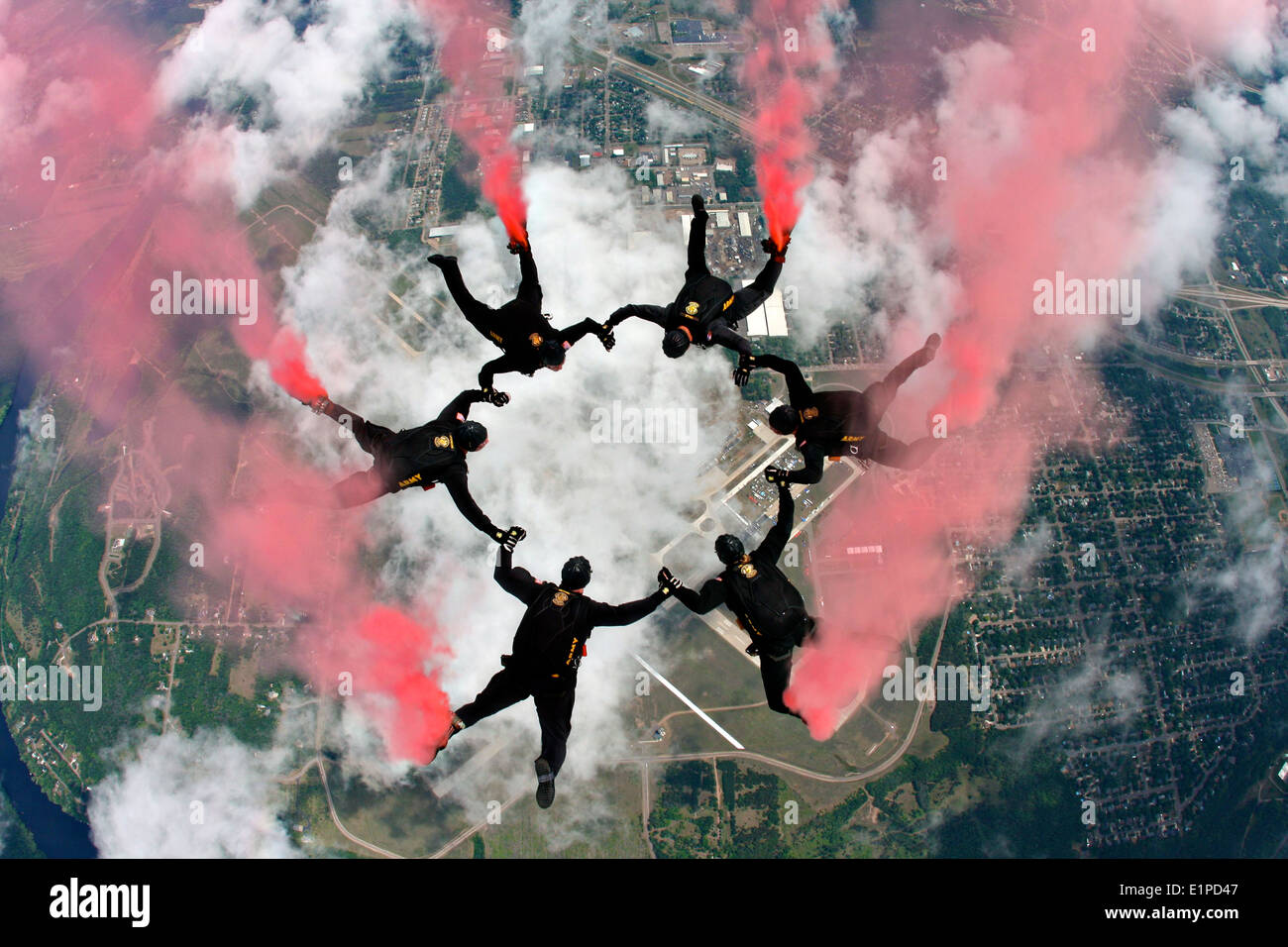 US Army Golden Knights Parachute Team practice a free fall with smoke June 4, 2010 over Eau Claire, Wisconsin. - Stock Image