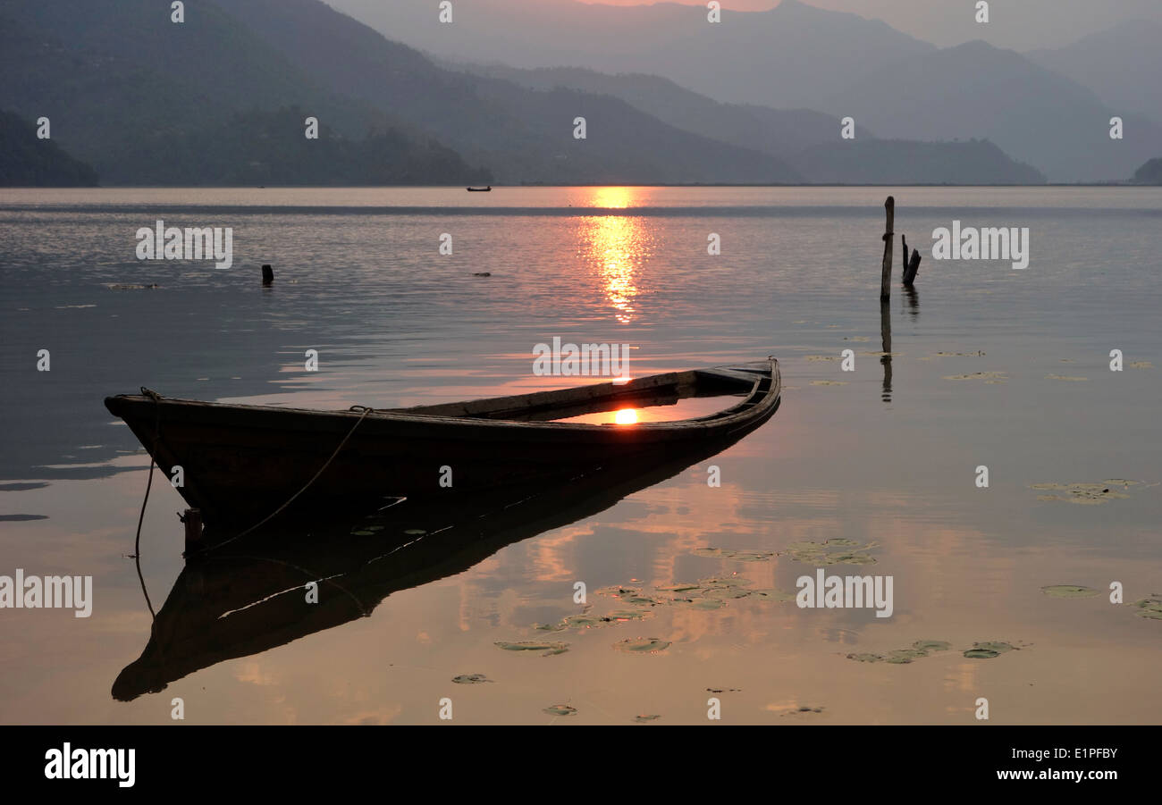 Wooden boat at sunset - Stock Image