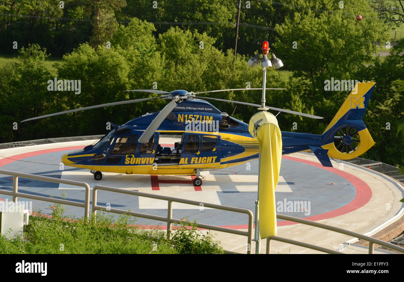 ANN ARBOR, MI - JUNE 3: One of the University of Michigan's Survival Flight helicopters sits at its helipad on June 3, 2014 in A - Stock Image