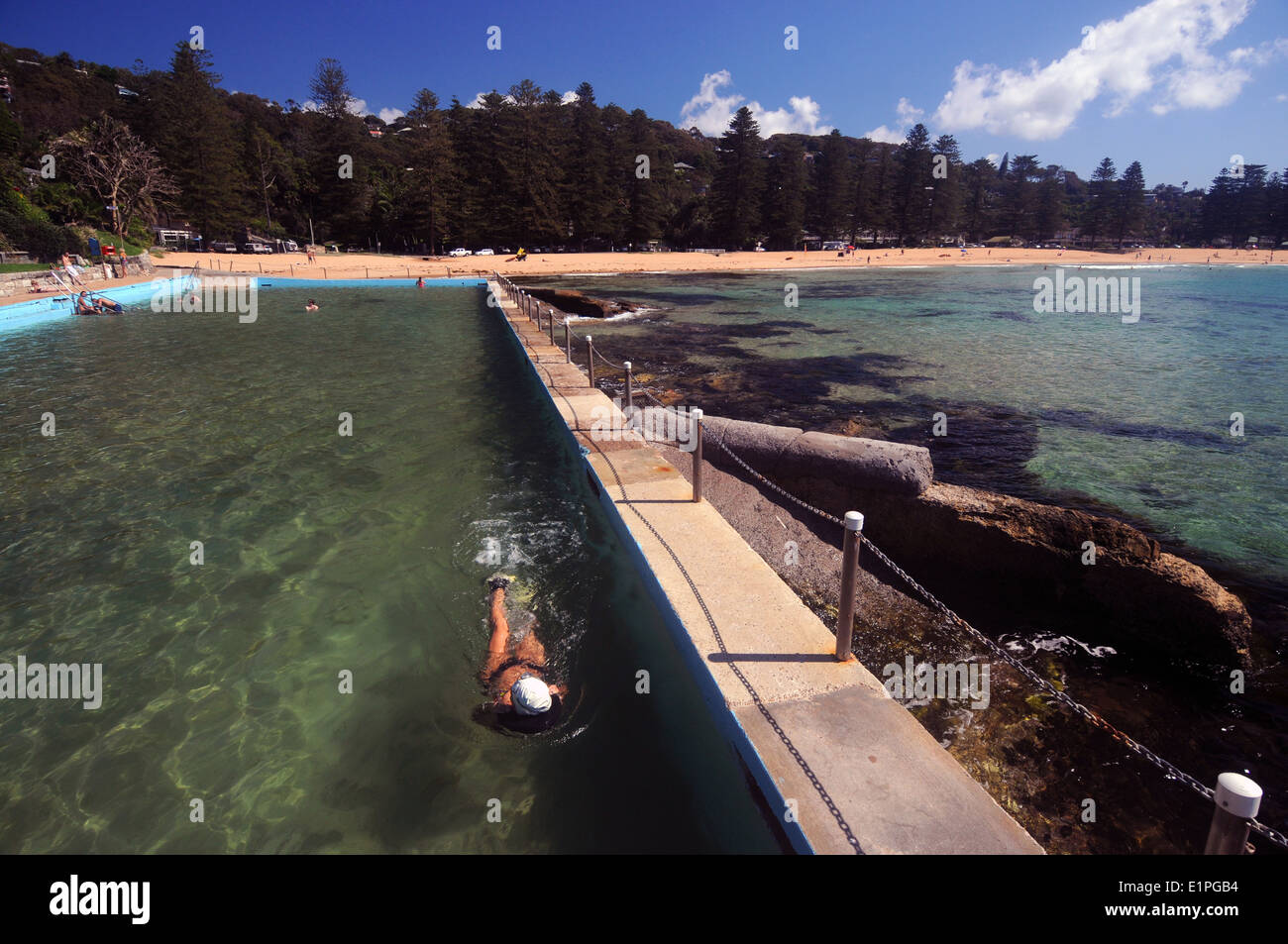 Woman swimming in rockpool at Palm Beach, northern beaches of Sydney, NSW, Australia. No MR - Stock Image