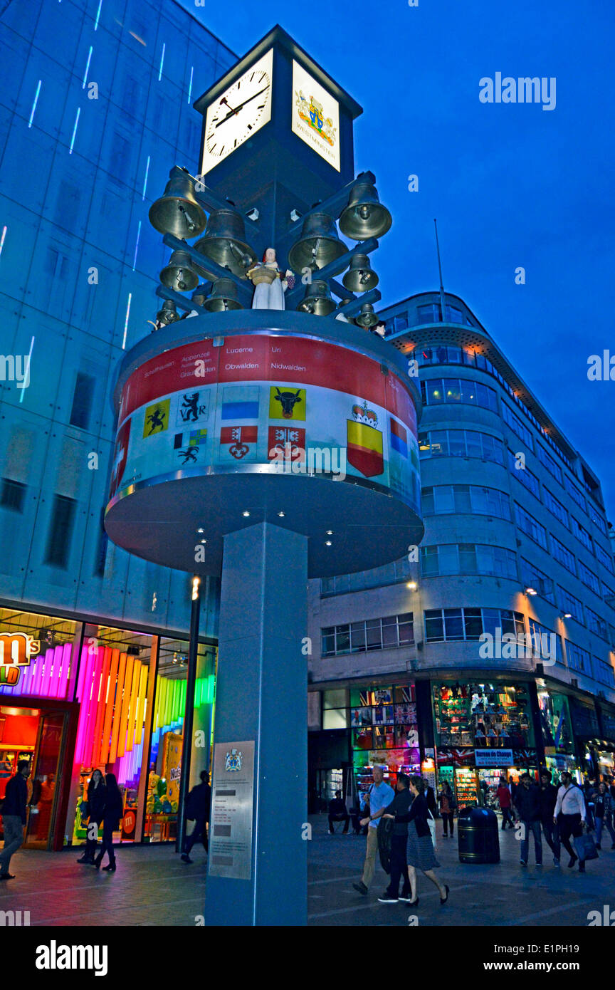 Leicester Square at night showing the Swiss Glockenspiel , West End,London, England, United Kingdom - Stock Image