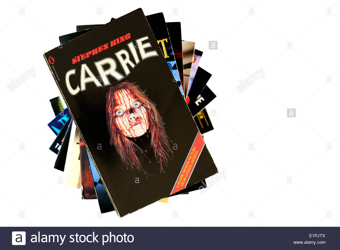 Stephen King paperback Carrie stacked used books, England - Stock Image