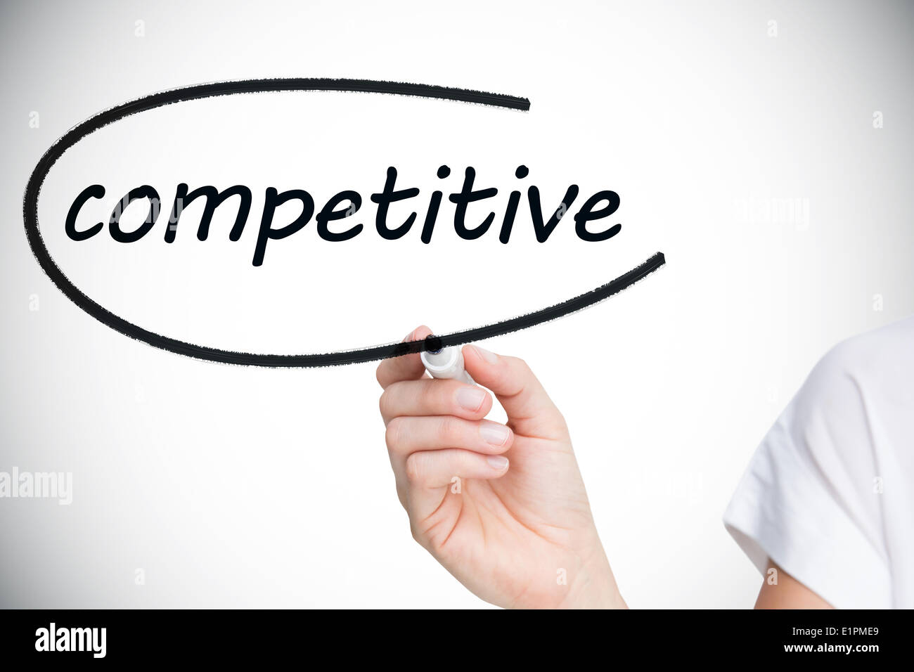 Businesswoman writing the word competitive - Stock Image
