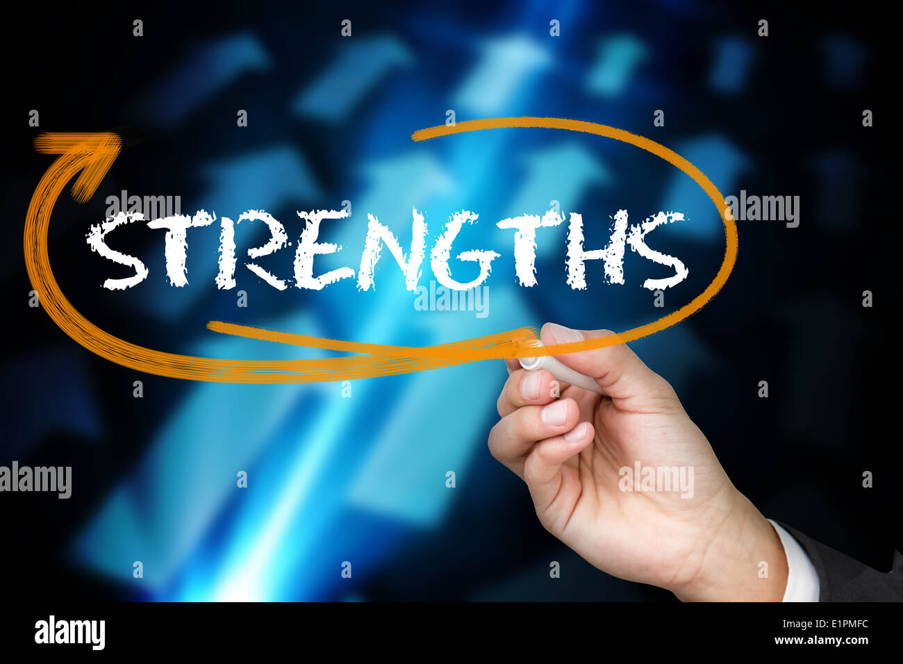 Businessman writing the word strengths - Stock Image