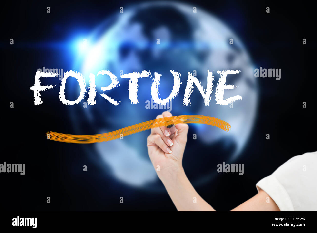 Businesswoman writing the word fortune - Stock Image