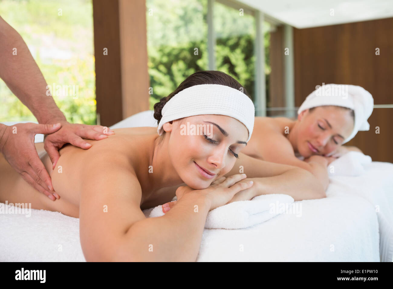 Pretty friends getting massages together - Stock Image