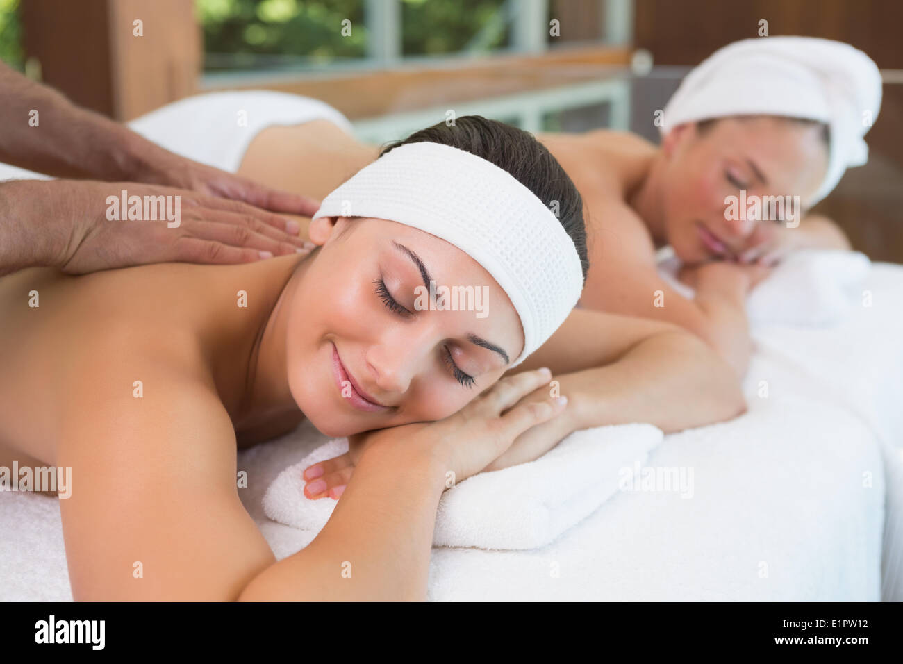 Pretty friends getting massages together Stock Photo