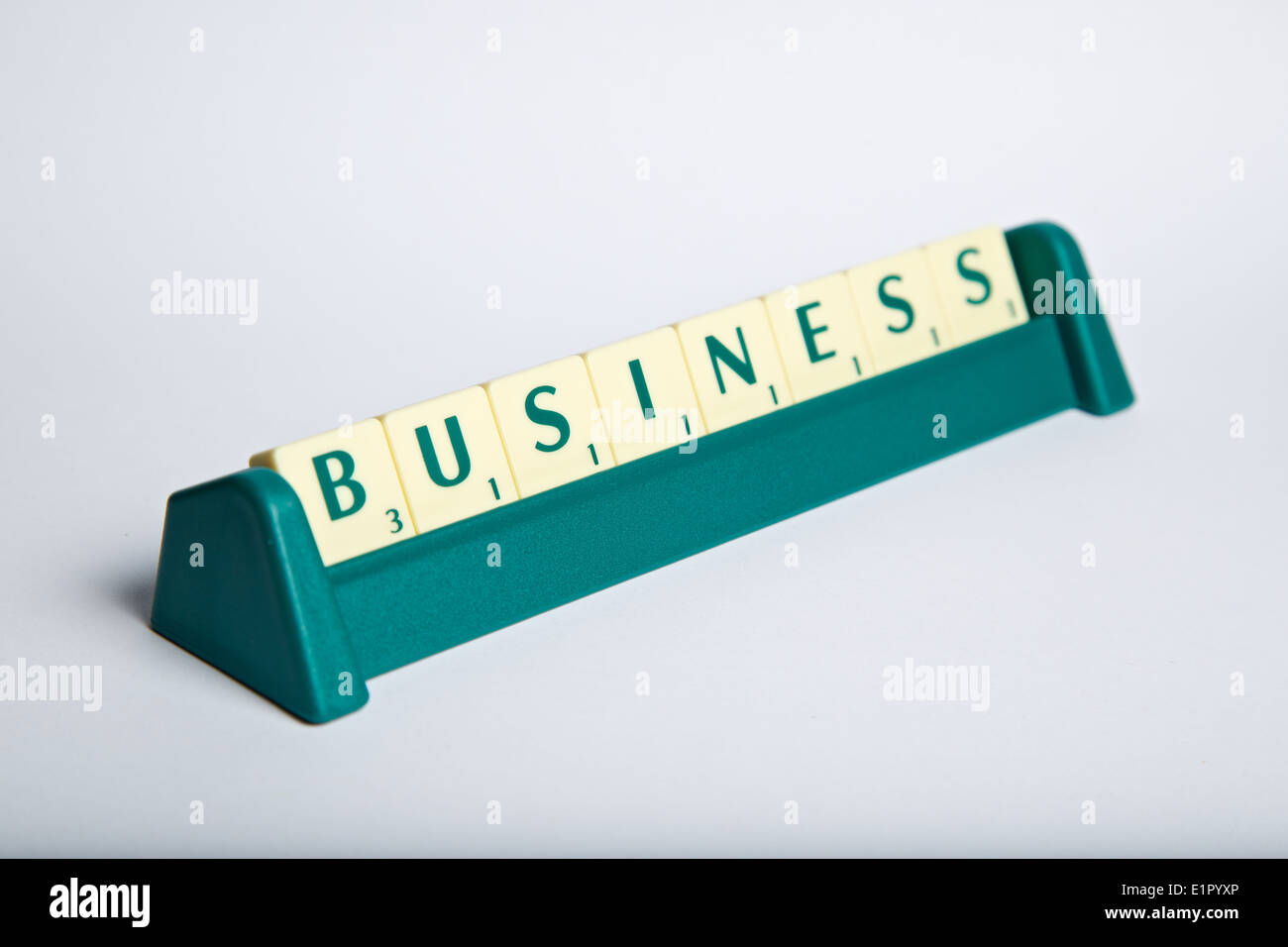 the word business in scrabble letters on a letter rack stock photo