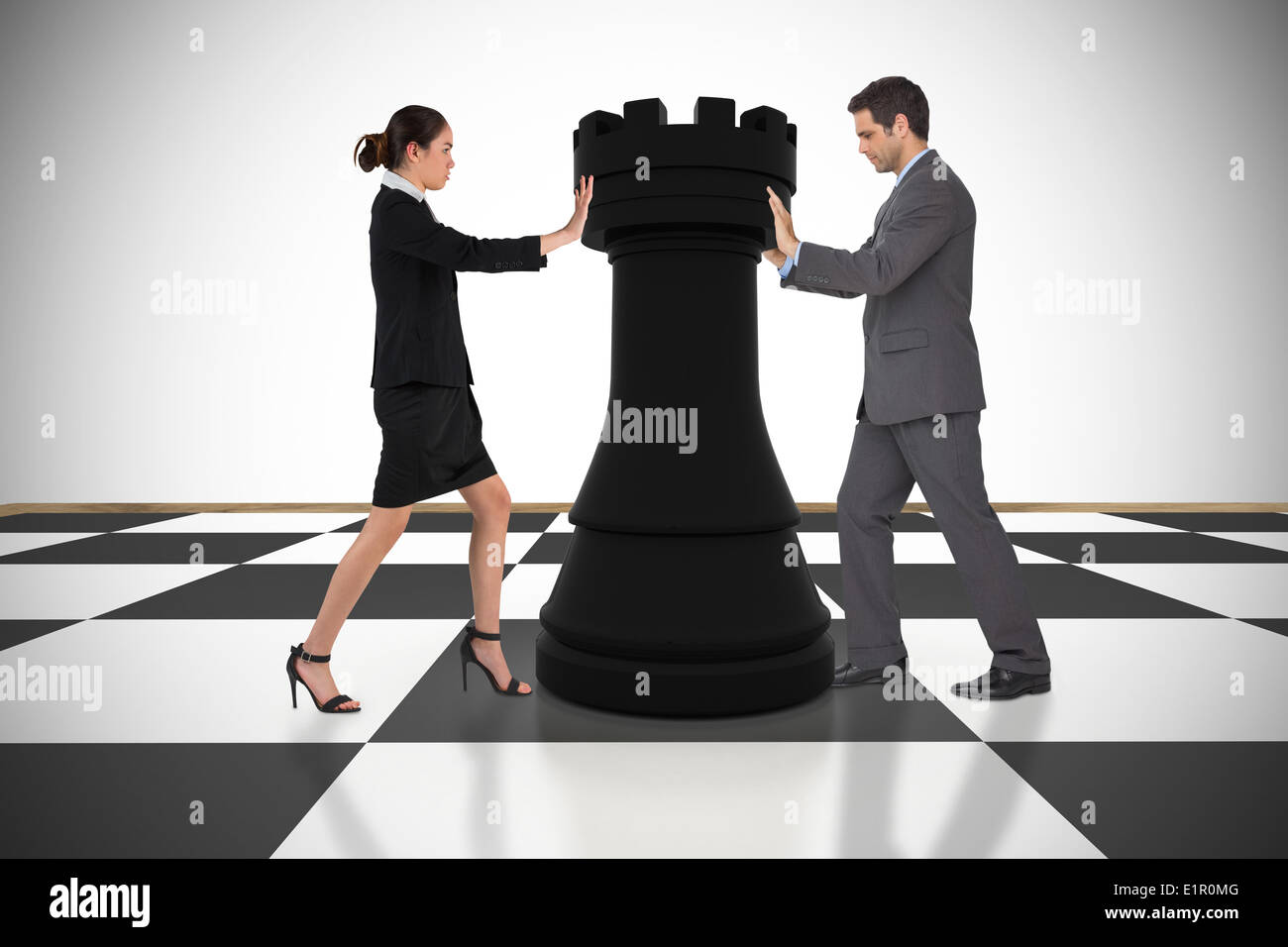 Composite image of business people pushing chess piece - Stock Image