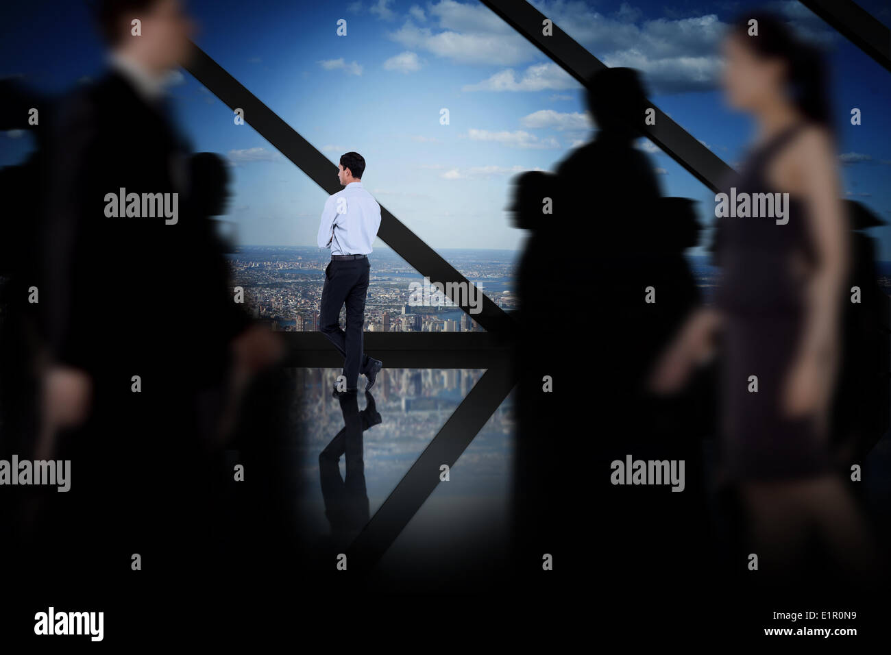 Composite image of business people walking in a blur - Stock Image