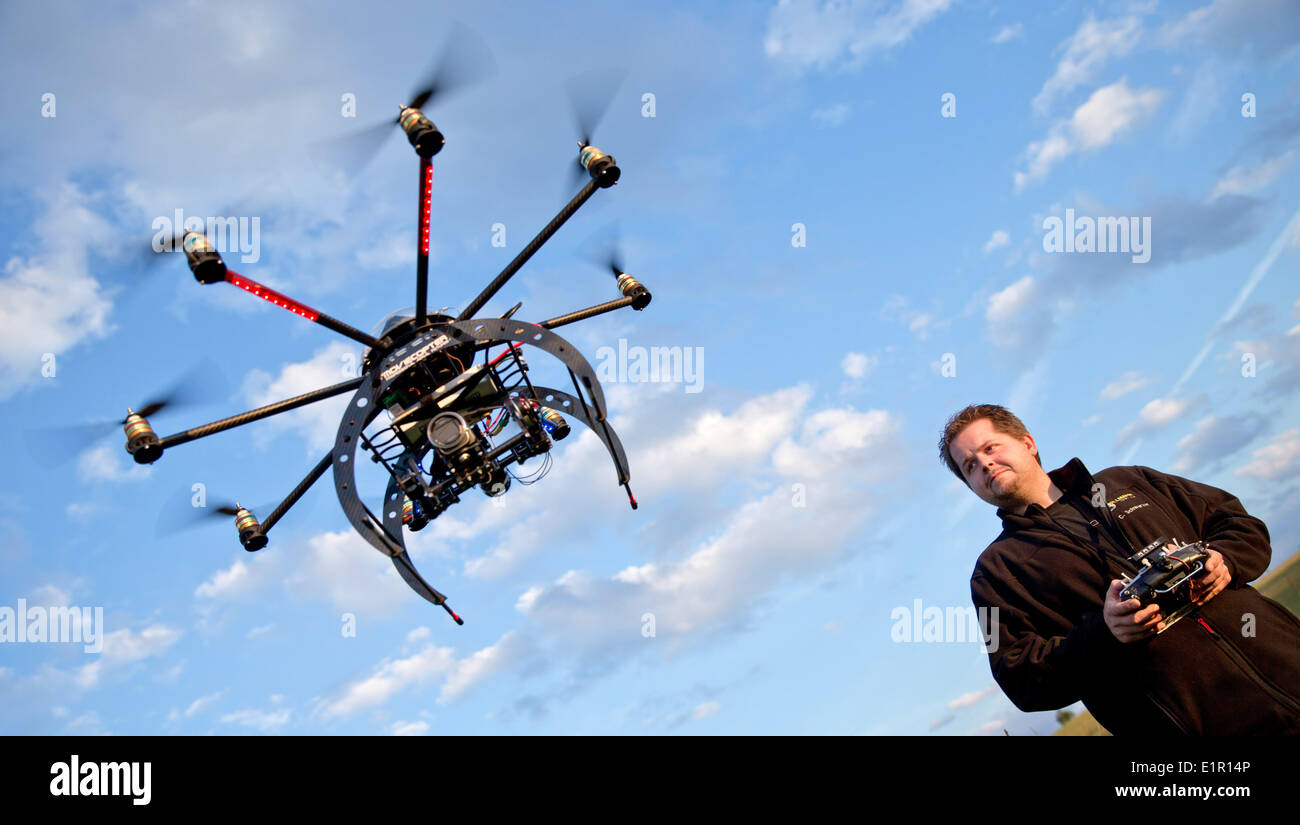 Erlangen, Germany. 05th June, 2014. Christian Schwarzer controls a so-called 'Moviecopter', a multirotor, near Erlangen, Germany, 05 June 2014. Multicopters are frequently used for aerial photographs in image movies. Photo: Daniel Karmann/dpa/Alamy Live News - Stock Image