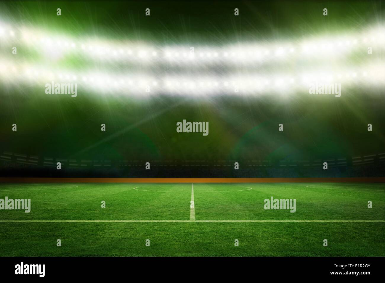 Football pitch under green lights - Stock Image