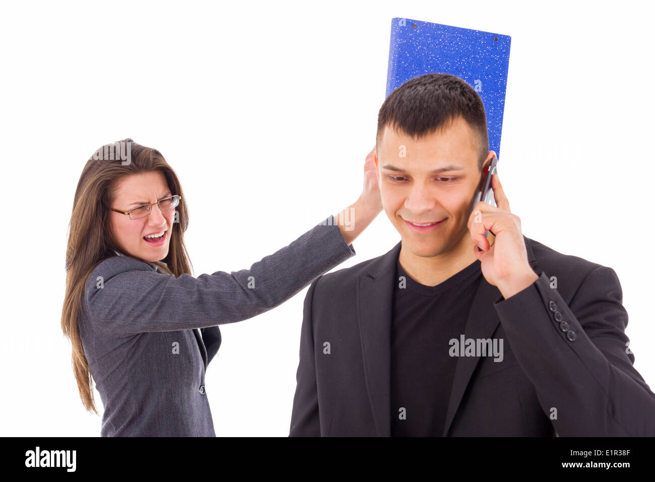 man cheating and woman punching him in head - Stock Image