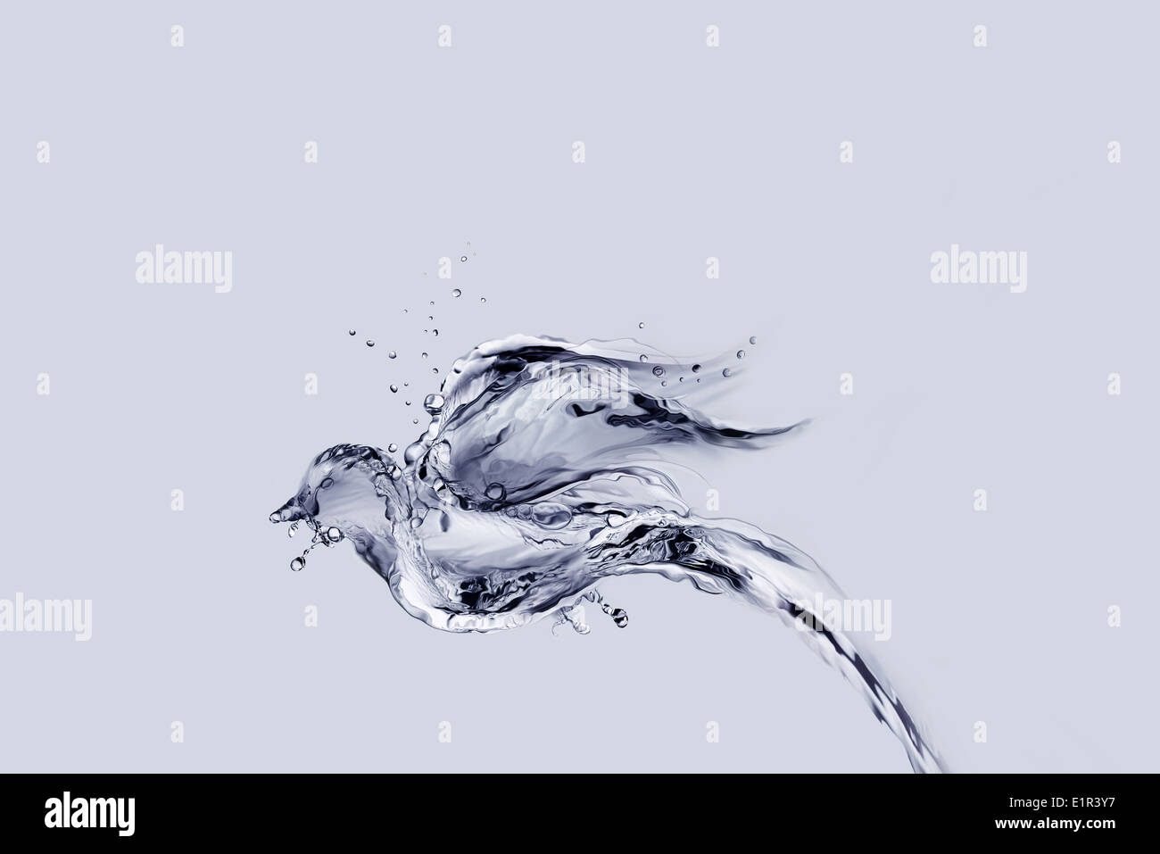 A bird made of water flying away. - Stock Image
