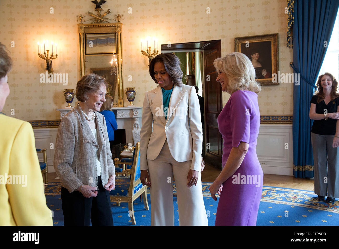 US First Lady Michelle Obama and Dr. Jill Biden speak with former First Lady Rosalynn Carter and former Senator Stock Photo