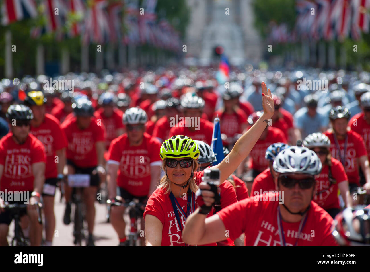 Colourful Hero Ride 2014 riders in The Mall, central London - Stock Image