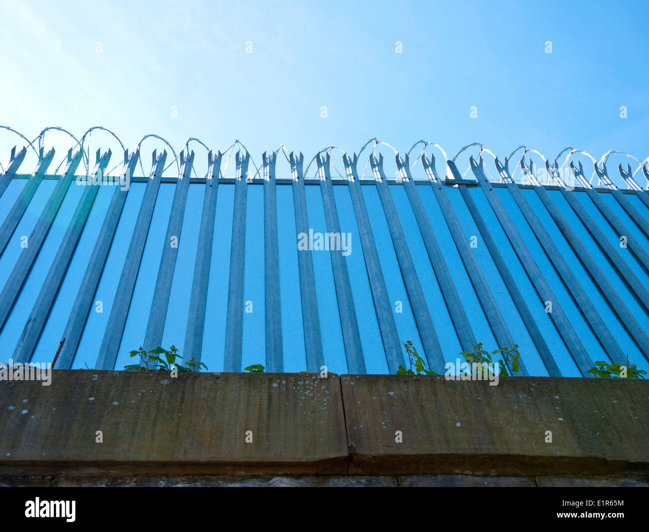 High security fence with razor wire. - Stock Image