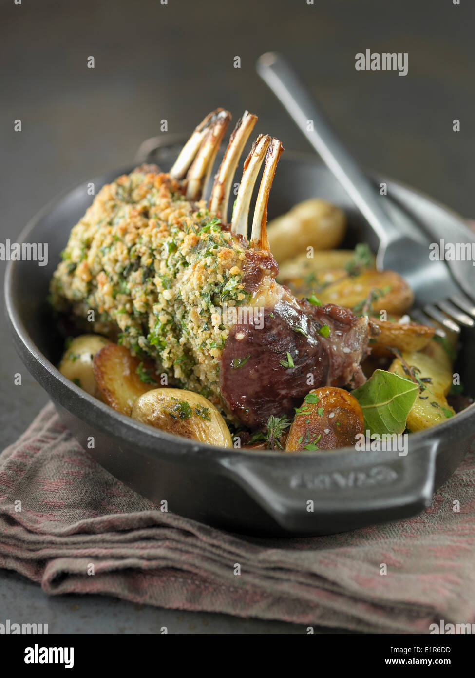 Loin of lamb in herb crust with Grenaille potatoes - Stock Image