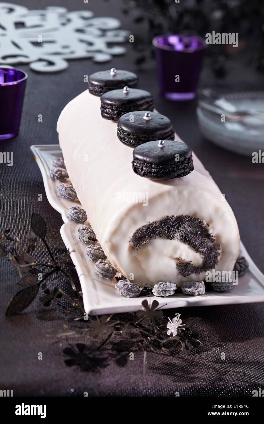 Mascarpone and poppyseed log cake - Stock Image
