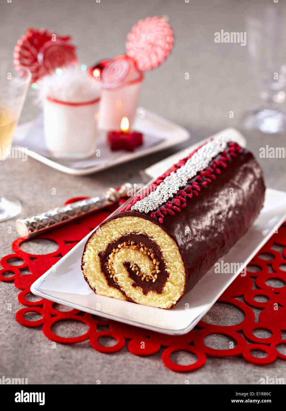 Chocolate and almond rolled log cake - Stock Image