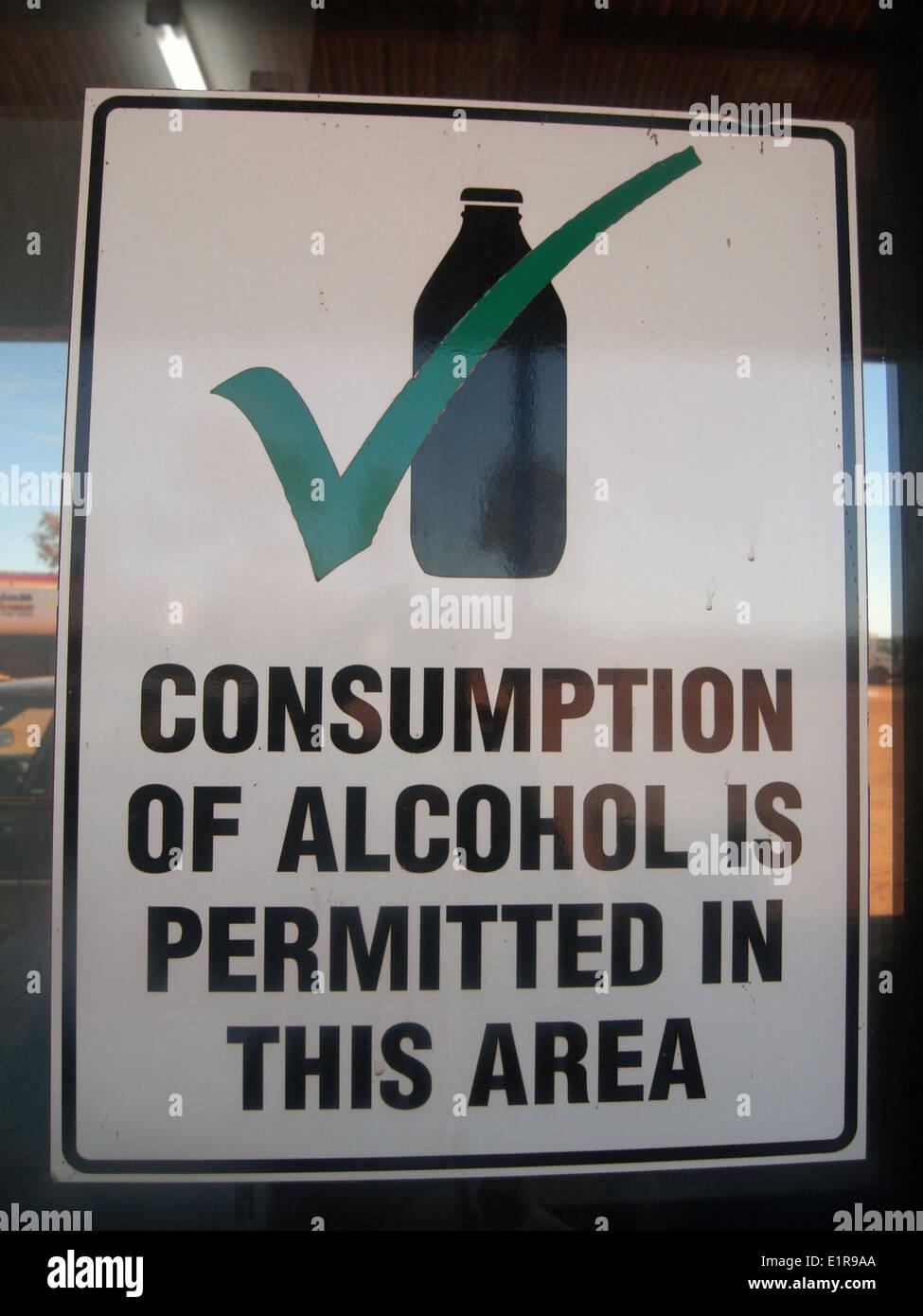 Sign permitting alcohol consumption, roadside truckstop in the Pilbara, Western Australia. No PR - Stock Image