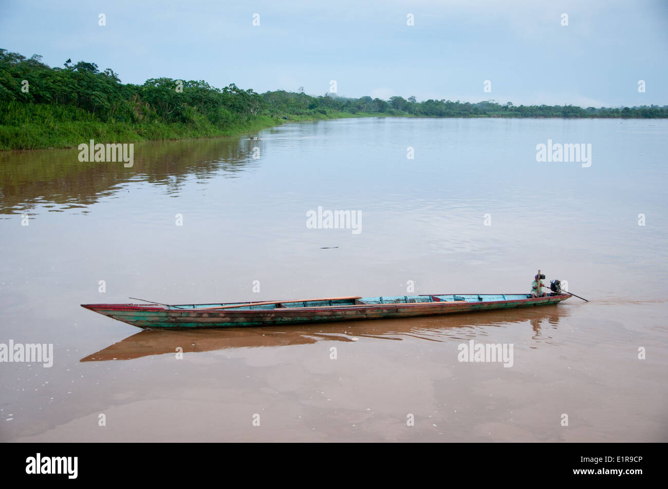 Large Canoe with outboard motor on the Peruvian Amazon - Stock Image
