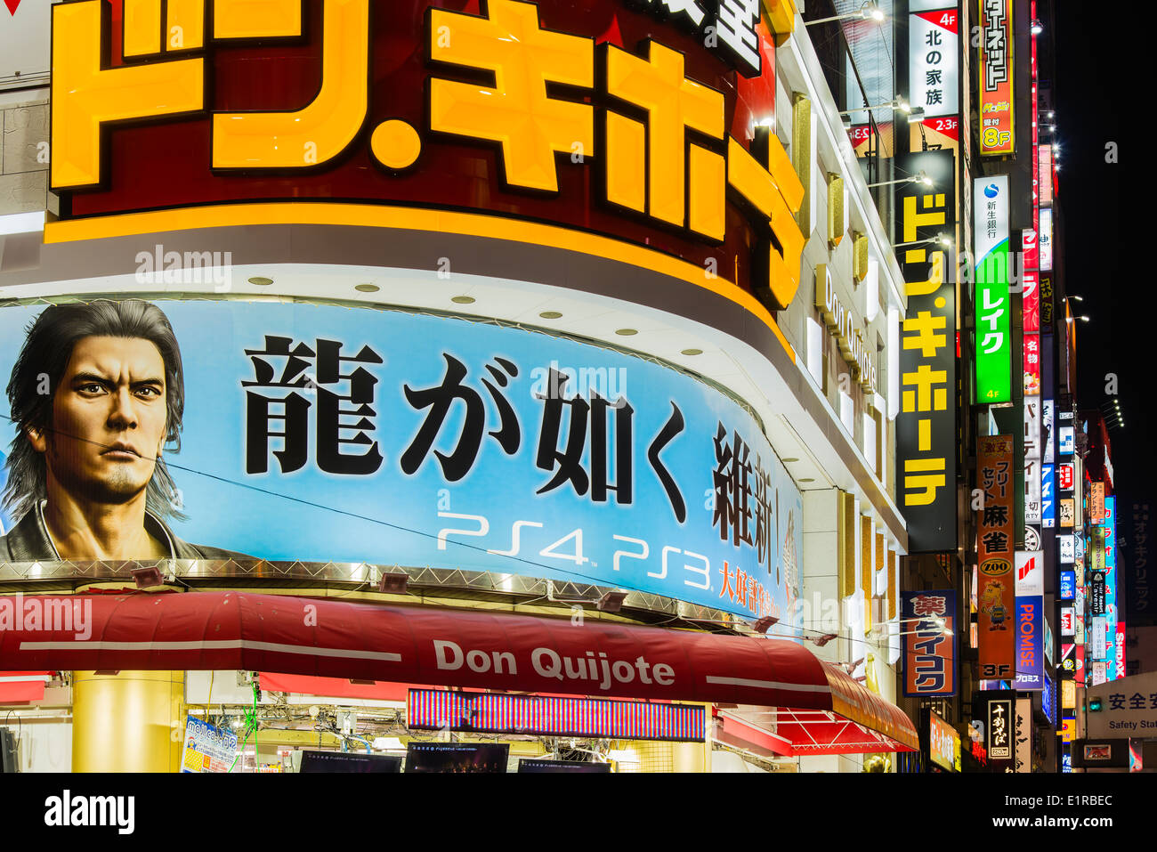 Colorful neon lights along Yasukuni-dori street, Shinjuku district, Tokyo, Japan - Stock Image