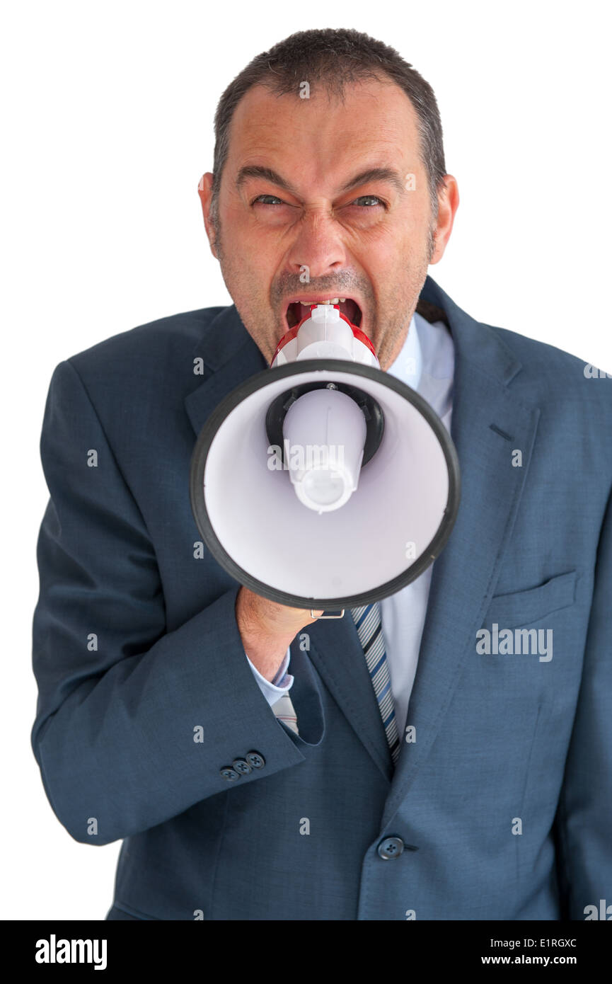 angry businessman shouting to camera through a loudhailer or megaphone - Stock Image