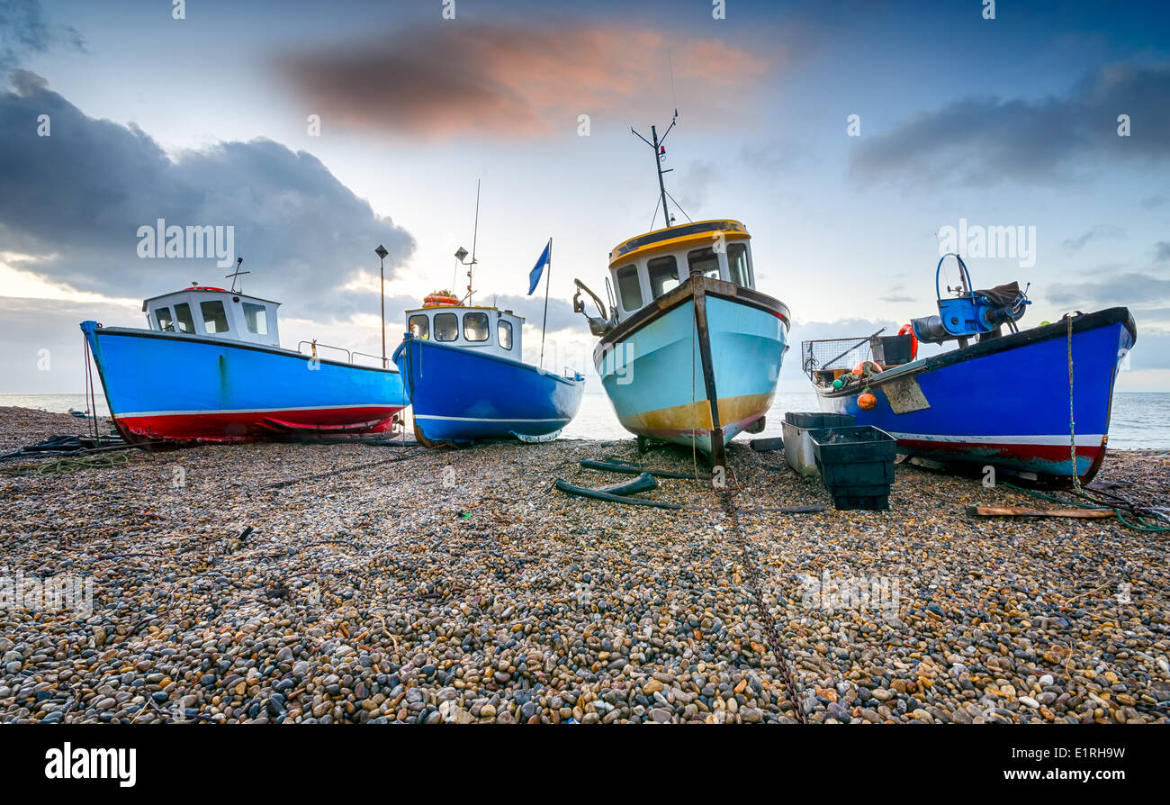 Fishing boats on a shingle beach at Beer in Devon - Stock Image