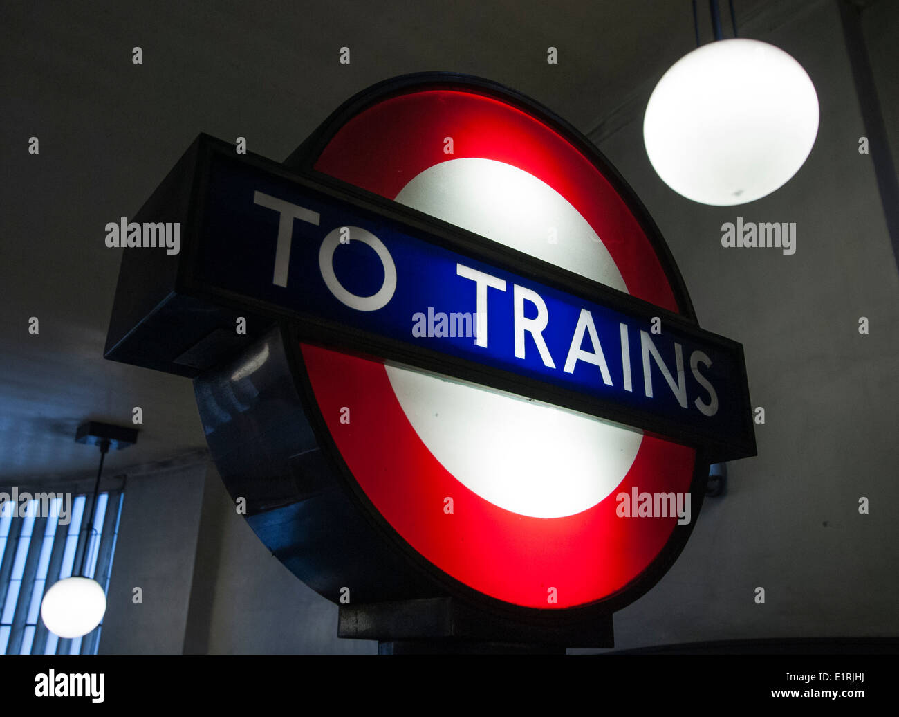 A sign pointing to trains on the London Underground, England UK - Stock Image