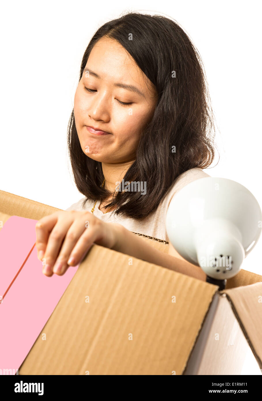 Asian woman with a moving box and pink slip - Stock Image