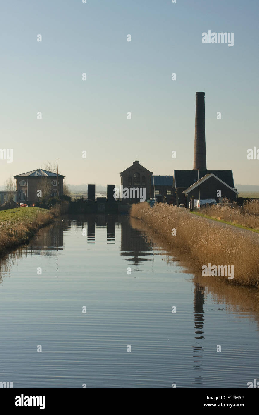 steam pump house which drains the land on a cold winters morning - Stock Image
