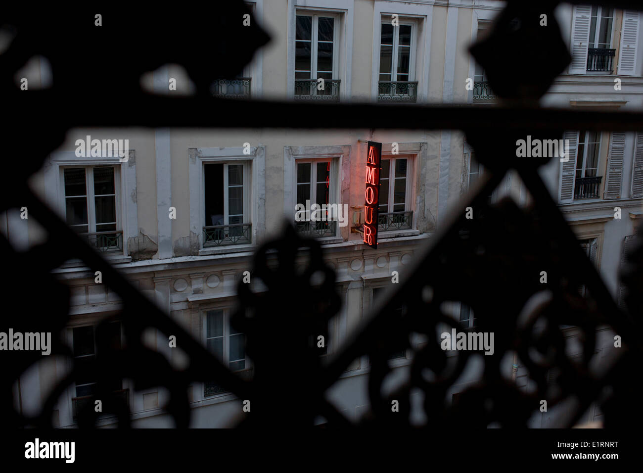 Neon sign outside the Amour Hotel at 8 rue Navarin, 9th Arrondissement, Paris, France. - Stock Image
