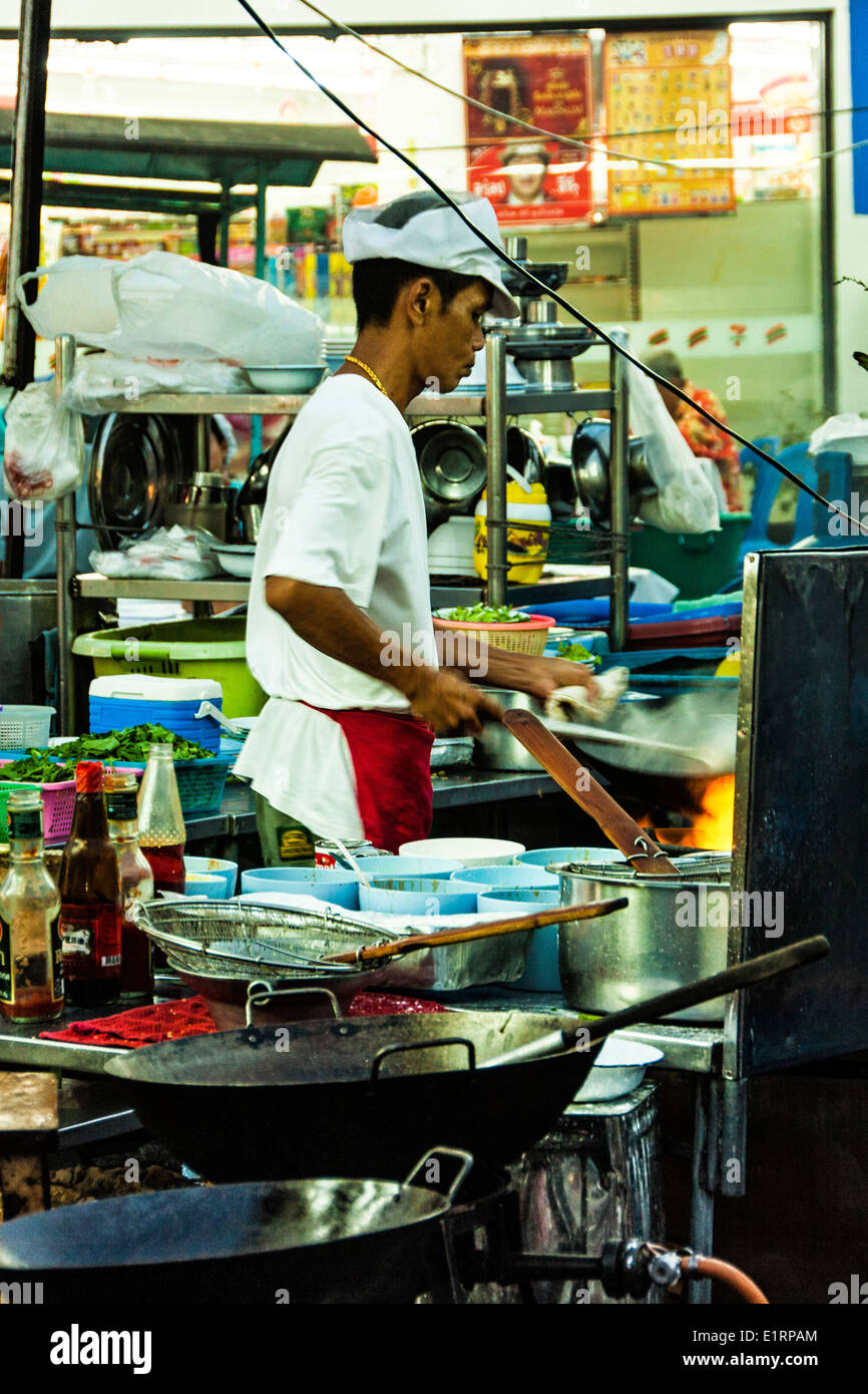 A street vendor cooks in downtown bangkok, Thailand Stock Photo
