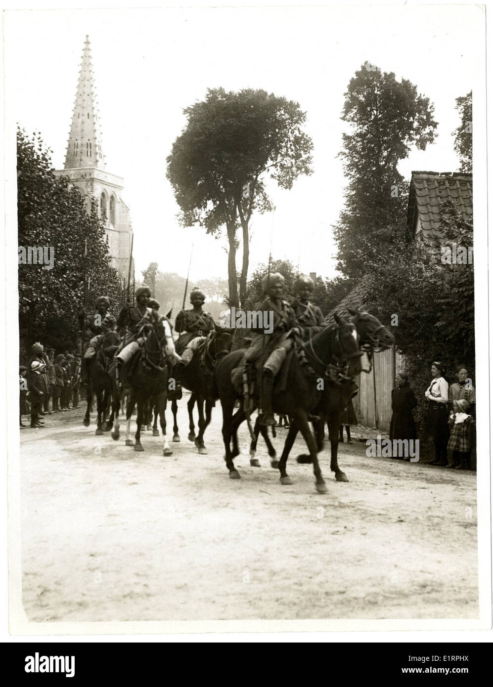 Indian cavalry marching through a French village [Estrée Blanche]. . - Stock Image