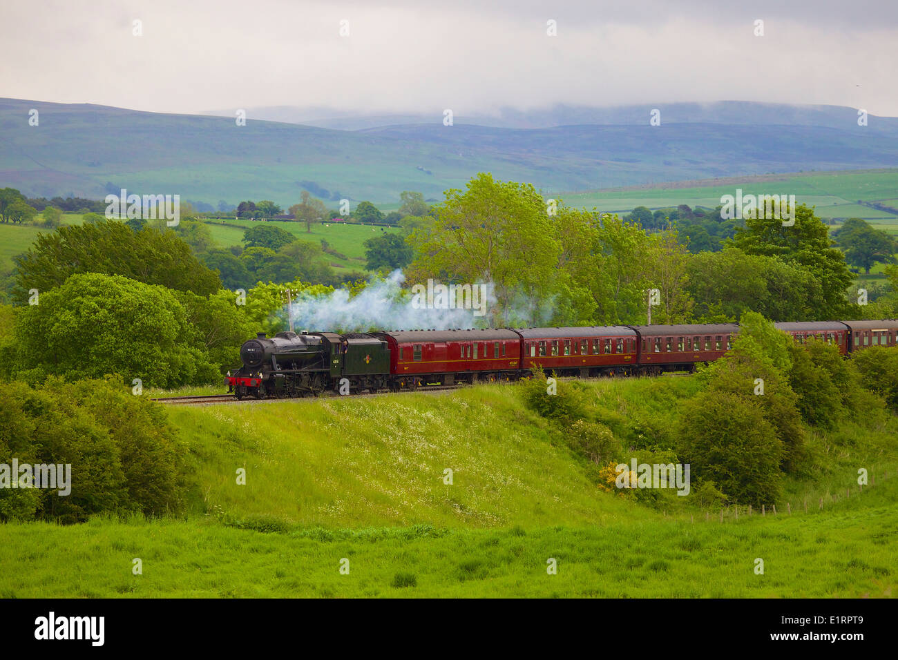 LMS Stanier Class 8F 48151, steam train near Duncowfold, Eden Valley, Settle to Carlisle Railway Line, Cumbria, England, UK. - Stock Image