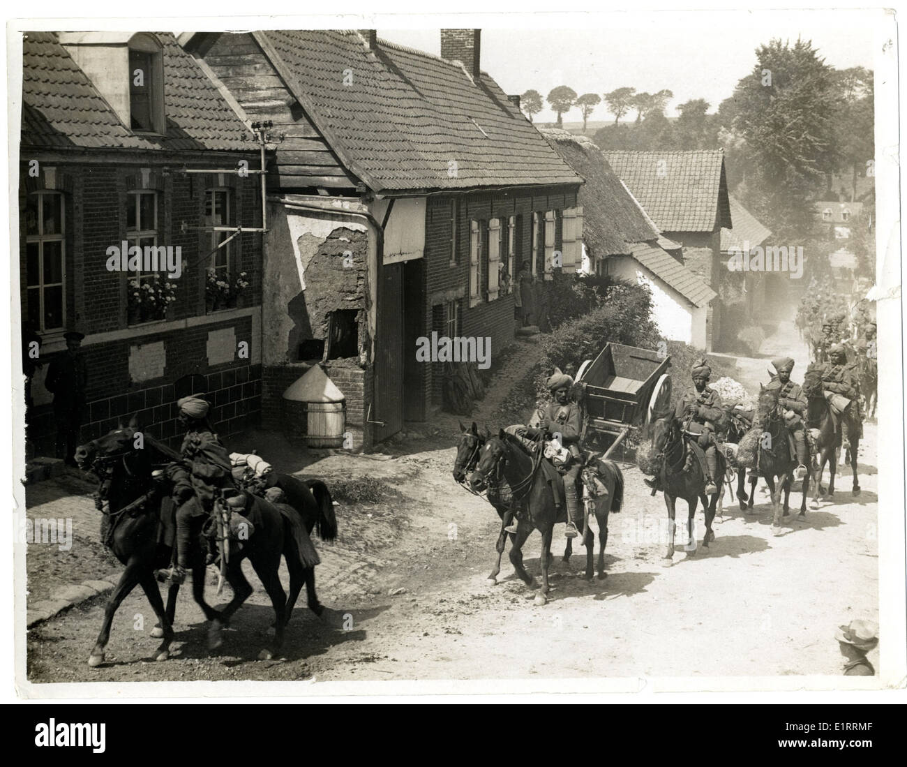 Indian cavalry marching through a French village [near Fenges]. . - Stock Image