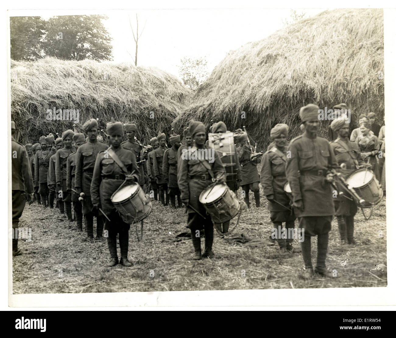 Indian infantry band playing on a French farm [St Floris, France]. . - Stock Image