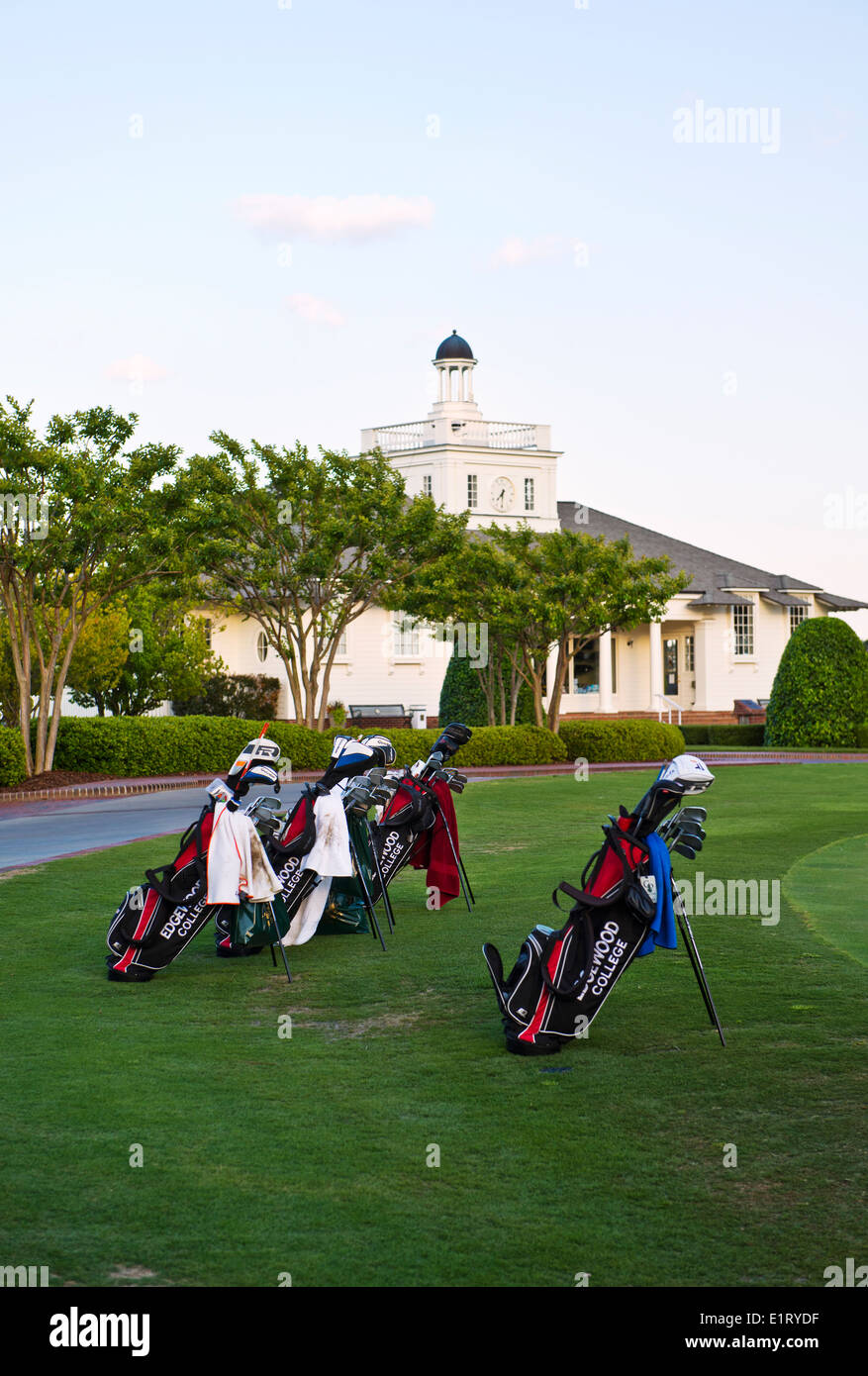 Golf Club Bags at the edge of the putting practice area at the clubhouse at Pinehurst Golf Resort & Country Club in Pinehurst NC - Stock Image