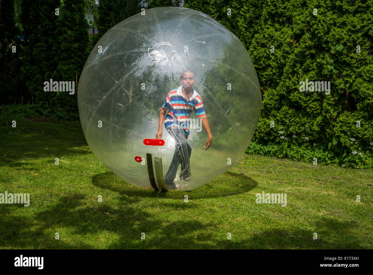 Boy in a bubble ball. - Stock Image