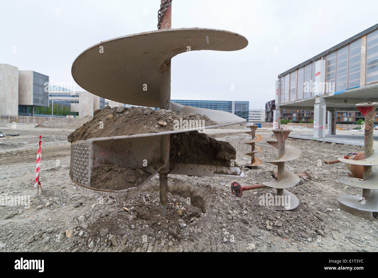 Drilling excavator with auger spiral attachment seen in Denmark - Stock Image